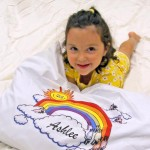 girl with personalized pillow case birthday gift
