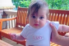 baby in personalized, monogrammed onesie