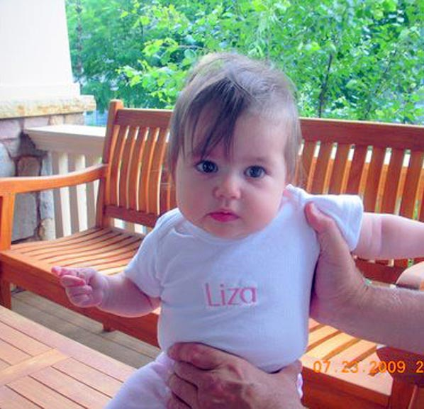 baby in personalized, monogrammed onesie