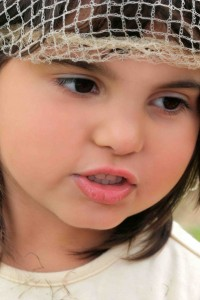 Face of a little girl with rosebud lips