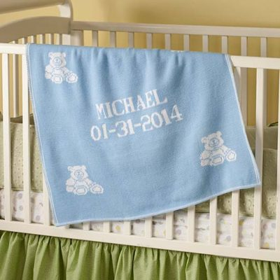 Personalized baby blankets for boys and girls. Gift on crib in nursery.
