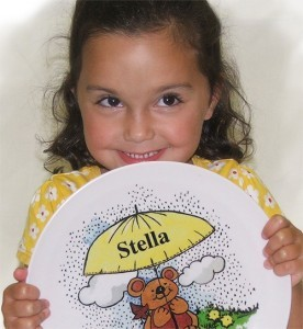 Stella showing off her new birthday present- a personalized dinner plate by Randesign