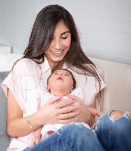 Portrait of beautiful happy single mom with cute little baby girl