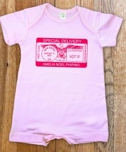 """Pink, personalized, """"Special Delivery"""" short for boys and girls. A cross between our famous rompers and onesies."""